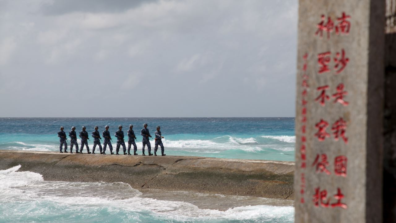 Chinese soldiers march in a line on the Spratly Islands in the contested South China Sea.