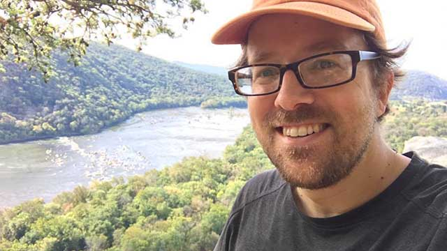 Portrait of Brian Williamson hiking on the Appalachian Trail on the bluffs over Harpers Ferry.